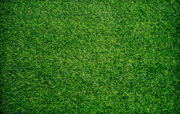 Vista superior do fundo verde da grama artificial. papel de parede e conceito de plano de fundo.