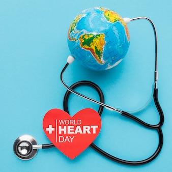 Vista superior do mundo coração dia conceito com globo