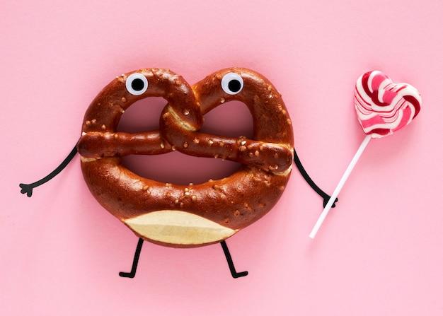 Vista superior do pretzel com chocolate e pirulito