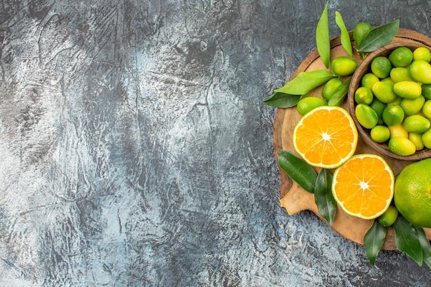 Vista superior do quadro de frutas cítricas com frutas cítricas na tigela laranjas tangerinas