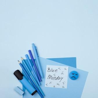 Vista superior do rosto triste com lápis para segunda-feira azul