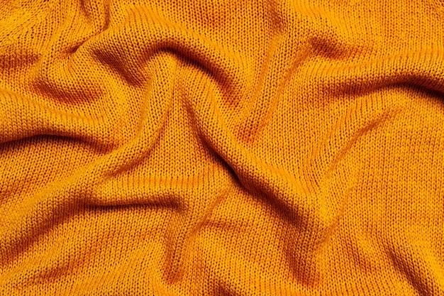 Vista superior do tecido de malha de lã laranja