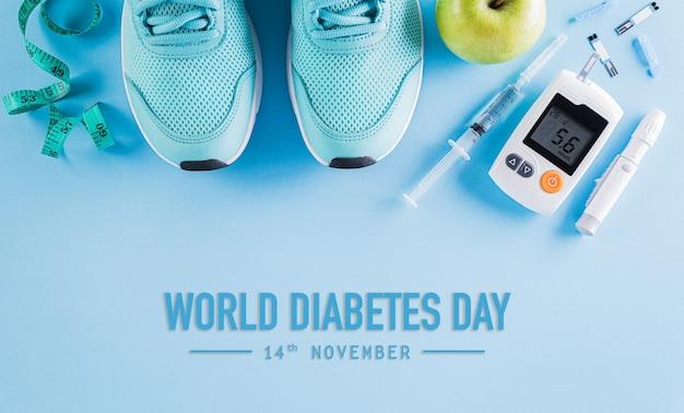 Vista superior do testador de diabetes com tênis, fita métrica e maçã verde