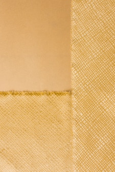 Vista superior elegante material dourado
