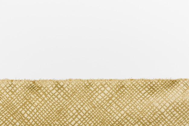 Vista superior elegante textura de tecido dourado