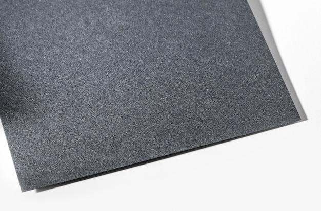 Vista superior em close-up de papel texturizado cinza