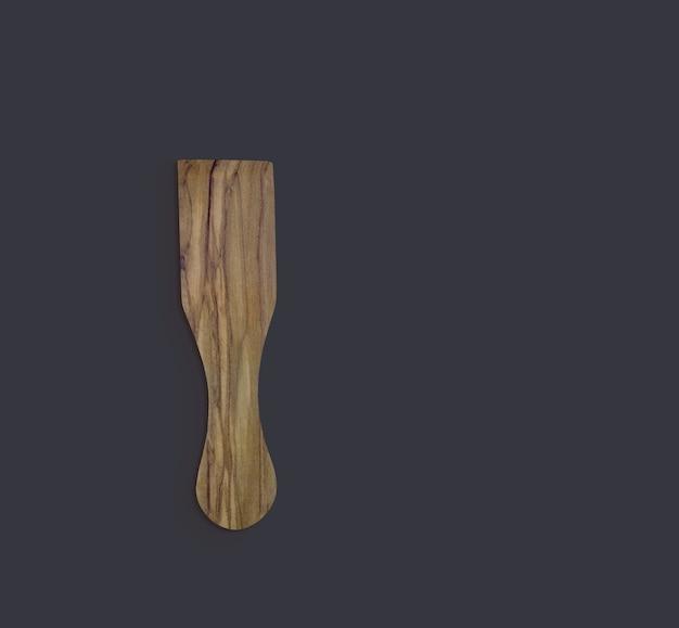 Vista superior espátula de madeira verde-oliva isolada no preto