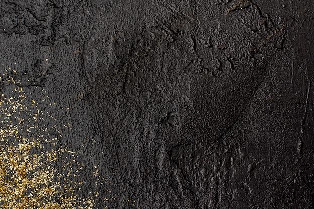 Vista superior fundo de ardósia com glitter dourado