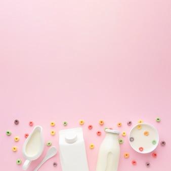 Vista superior garrafa de leite com tigela e cereais