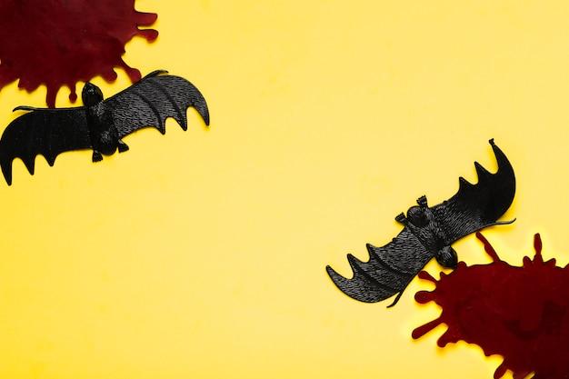 Vista superior manchas escuras e morcegos