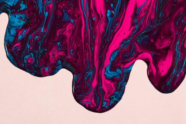 Vista superior misturada de tinta rosa e azul