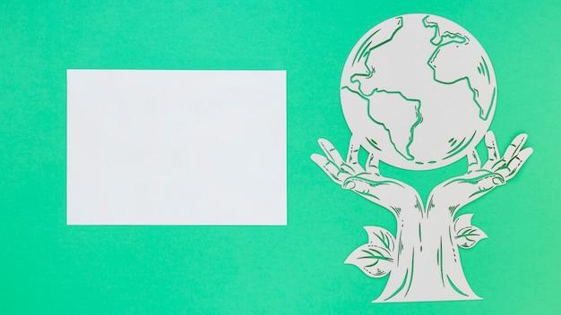 Vista superior mundo ambiente dia objeto de madeira sobre fundo verde