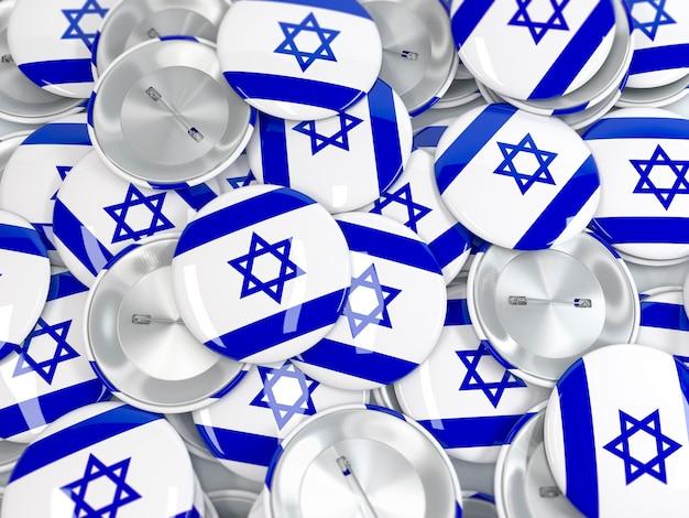 Vista superior na pilha de emblemas de botão com a bandeira de israel. renderização 3d realista