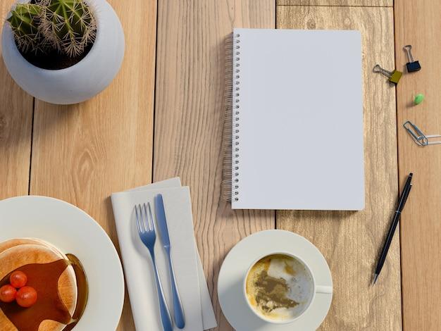 Vista superior na tabela com café, bolo e caderno.