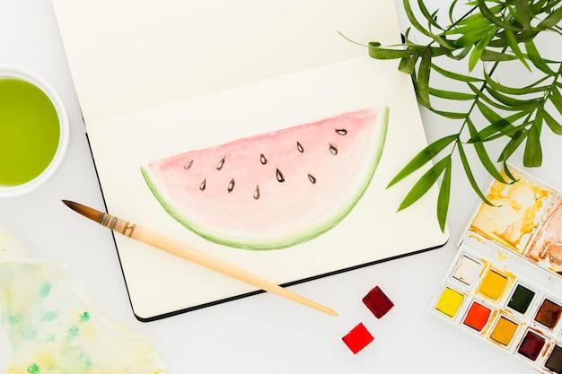 Vista superior pintura de melancia em cima da mesa