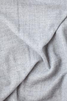 Vista superior sobre textura de textil cinza de lã macia