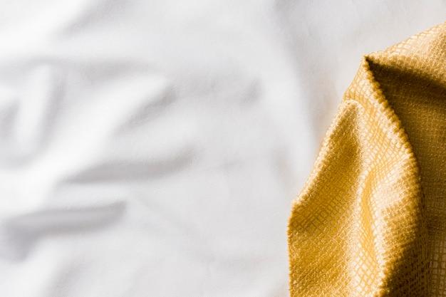Vista superior textura de tecido dourado