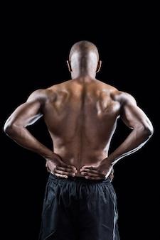 Vista traseira, de, muscular, atleta, esticar, com, passe quadril
