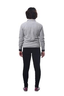 Vista traseira de uma mulher com roupas esportivas em fundo branco