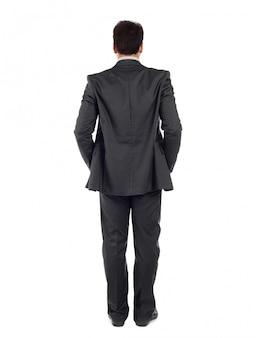 Vista traseira do corpo inteiro de um homem de negócios de terno preto.