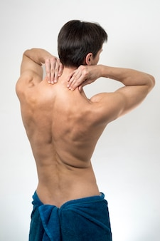 Vista traseira, homem, massaging, seu, pescoço