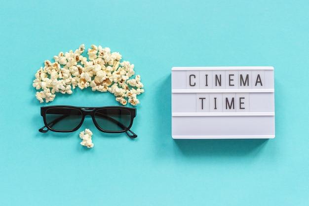 Visualizador abstrato, óculos 3d, pipoca e texto de caixa de luz tempo de cinema conceito cinema filme e entretenimento