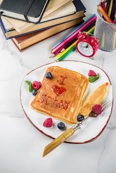 Volta ao conceito de escola, panquecas de café da manhã