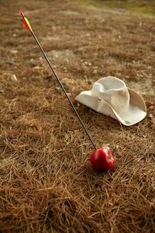 William dizer metáfora com maçã vermelha e seta