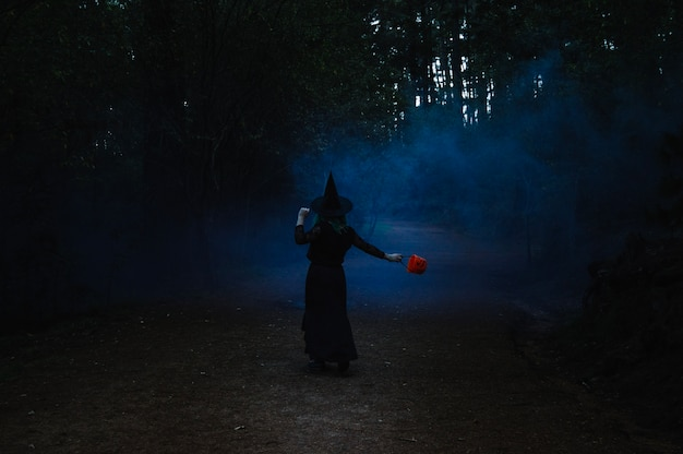Witch dancing in dark forest