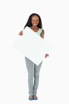Woman holding placeholder on white background
