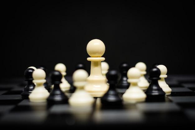 Xadrez (penhor) para líder fundo ou textura - negócios e conceito de estratégia.