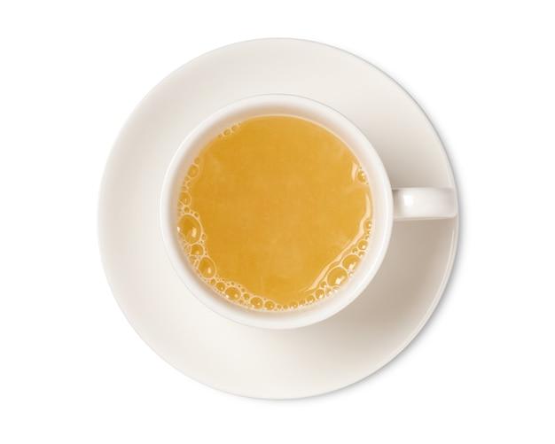 Xícara de chá de gengibre, isolada na vista superior do espaço em branco. com traçado de recorte.