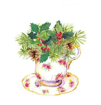 Xícara de chá de natal com galhos de árvores