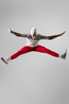 Young breakdancer jumping