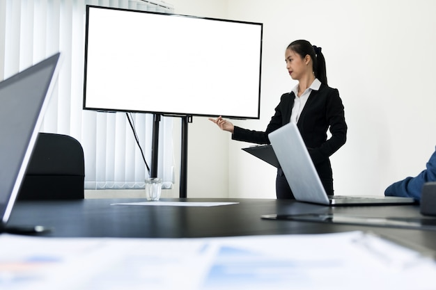 Young business man working presentation using television computer of the blank screen