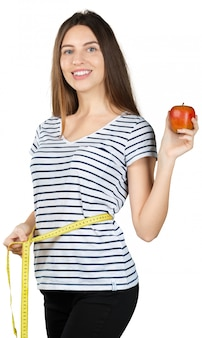 Young cabe mulher com uma fita métrica isolada no fundo branco