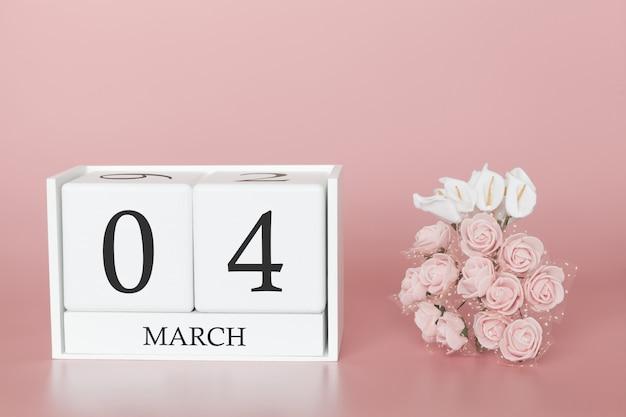 04. märz. tag 4 des monats. kalenderwürfel auf modernem rosa