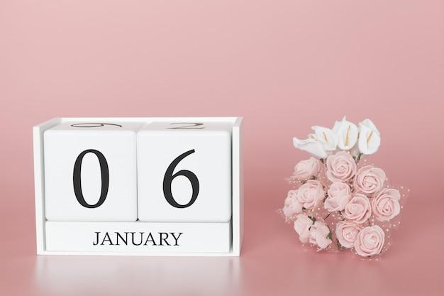 06. januar. tag 6 des monats. kalenderwürfel auf modernem rosa hintergrund