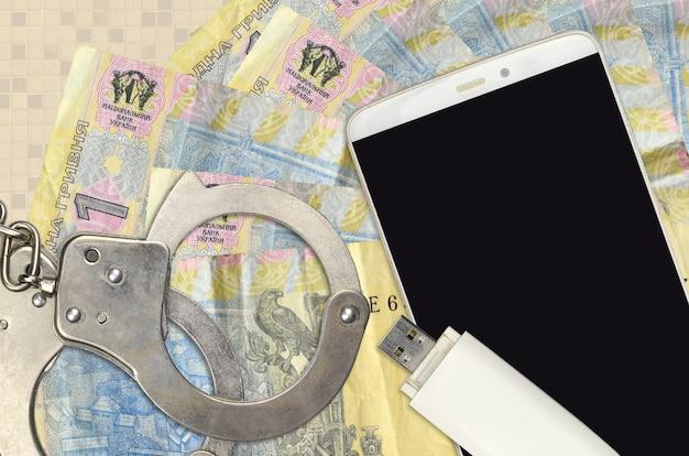 1 ukrainische griwna-rechnungen und smartphone mit polizeihandschellen