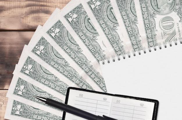 1 us-dollar-scheinfächer und notizblock mit kontaktbuch und schwarzem stift