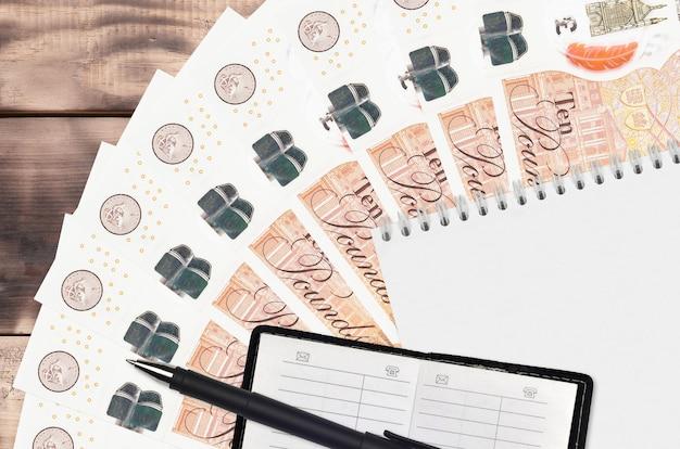 10 britische pfund rechnungen fan und notizblock mit kontaktbuch und schwarzem stift