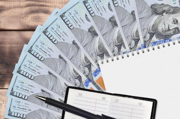 100 us-dollar-scheine fan und notizblock mit kontaktbuch und schwarzem p