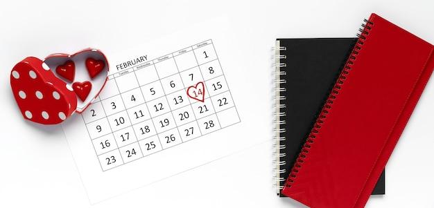 14. februar kalender mit süßigkeiten herzform und notizbüchern. flache lage, draufsicht. valentinstag konzept