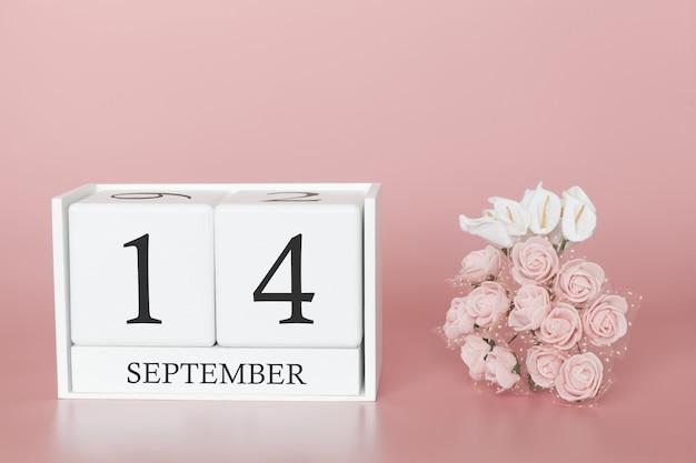 14. september. tag 14 des monats. kalenderwürfel auf modernem rosa hintergrund, konzept des geschäfts und einem wichtigen ereignis.