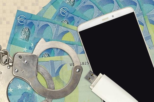 20 euro-scheine und smartphone mit polizeihandschellen
