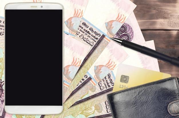 20 srilankische rupien rechnungen und smartphone mit geldbörse
