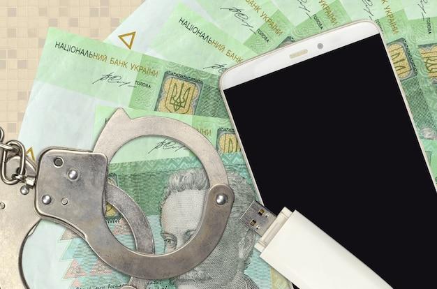 20 ukrainische griwna-rechnungen und smartphone mit polizeihandschellen