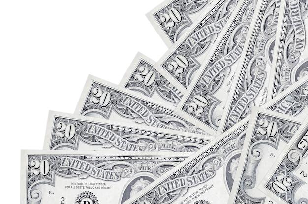 20 us-dollar-scheine liegen in unterschiedlicher reihenfolge isoliert auf weiß