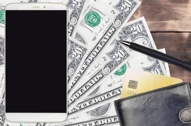20 us-dollar-scheine und smartphone mit geldbörse und kreditkarte