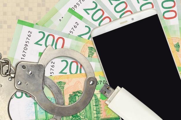200 russische rubel rechnungen und smartphone mit polizei handschellen